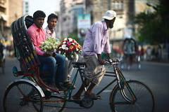 THE NEWLY MARRIED COUPLE (N A Y E E M) Tags: men rickshaw flower bouquet candid colours friday afternoon light street noramedroad chittagong bangladesh windshield sooc raw unedited untouched