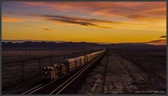 First light - first train by Schnitzel_bank - UP #2722 and #7173 lead a auto rack train westbound near Sinclair / WY
