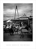 Beers beneath the bridge (Parallax Corporation) Tags: blackwhite sonya7rii sonyfe55mmf18 beergarden millenniumbridge southportmarina southportpier holidaymakers benches