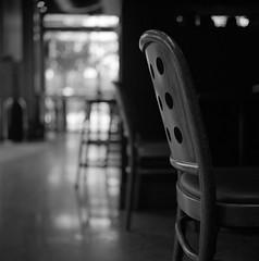 Coffee shop chair (ASHLANDJET) Tags: film rolleiflex 35e planar ilfordxp2 mediumformat analog blackandwhite monochrome epsonv500 coffeeshop chair square 6x6 vintagecamera tlr