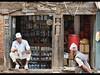 Street scene, Kathmandu, Nepal (jitenshaman) Tags: travel destinations worldlocations asia asian nepal nepali kathmandu bhaktapur durbarsquare sit sitting scene street traditional tradition culture topi hat shop shopkeeper relax rest portrait streetlife vendor shops store market