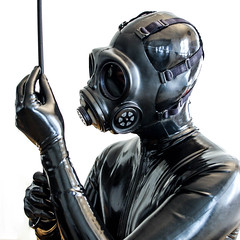 Inspecting the equipment for new year's eve ! (Latex Noxx) Tags: crop gloves latex mask vigilante gasmask catsuit fetish domination gasmaskfetish glovefetish rubber