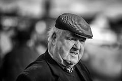 A man with a check cap (Frank Fullard) Tags: frankfullard fullard candid street portrait ballinasloe galway irish ireland cap check monochrome face jowls fair blackandwhite farmer