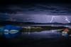 Lightening strikes (giallorossi5) Tags: bolivia lagotiticaca titicaca lightening night storm lake sail boat reflection longexposure