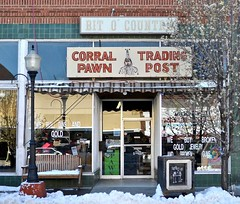 Corral Pawn and Trading Post - Trinidad,Colorado (Rob Sneed) Tags: snow bench usa colorado trinidad corralpawntradingpost business independent urban downtown shopping pawnshop vintage neon lamppost windows americana smallbusiness commercial brick tile bitocountry smalltown streetlight