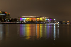 Kennedy Center Lensbaby (johngoucher) Tags: approved sky water river waterfront potomacriver georgetownwaterfrontpark georgetown washingtondc washington dc kennedycenter kennedycenterhonors rainbow lights winterlights illumination reflection cityscape nightscape lightscape architecture lensbabysweet35 lensbaby sweet35
