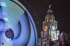 Liverpool at Christmas, Cutting edge stuff. (alundisleyimages@gmail.com) Tags: liverbuilding liverpool fairground ride longexposure night architecture lighttrail clocks buildings merseyside portsandharbours waterfront northwestengland