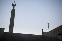 Never Forget. (Mill(s) & NAJE) Tags: erevan street photography lobjectif robinhood mills gefelko naje canon canon5d 40mm fixe objectif color meet people travel monument capital boy armenia photographie voyage finger blue sky grey composition