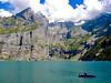 Oeschinensee Lake - Switzerland (CamposPedro) Tags: sky water grass switzerland suiça montanha mountain kandersteg oeschinensee lake lago lagoglacial graciallake barco boat rowing remando