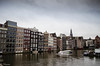 Amsterdam (DimitrisK.) Tags: amsterdam canals canal holland nederlands boat outdoor clouds water nikon d5100 city sky river building people houses cloudy