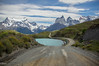Recipe to create a majestic scene - throw in some Wind to sharpen the mountains, powder it with some snow, melt some glaciers to form a lake and dab with some lush green tree - voila! (teena.angale) Tags: torresdelpaine patagonia loscuernos lakepehoe chile blue mountain mountains road journey snow sky white flowers path