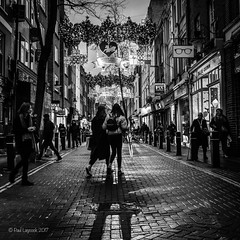Night Shopping (amipal) Tags: 175mm capital city england gb greatbritain london lowlight manuallens night people street uk unitedkingdom urban voigtlander