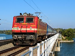 16303 Vanchinad express. (Gautham Karthik) Tags: train indianrailways electriclocomotive wap4 cherryred trainspotting trainspotter railroad trainphotography photography vanchinadexpress bridge paravurlake kerala morning light sunnyday