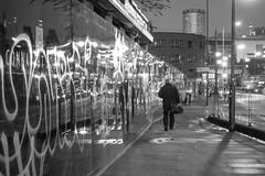 20180103-Walking to Birmingham (Damien Walmsley) Tags: rotunda graffiti boardings light figure walking birmingham blackandwhite streetphotography morning early dailycommute
