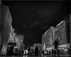 Walk (freshandfun) Tags: blackandwhite bw malta valletta citygate night nightphotography nightshot light winter christmastree people xmas