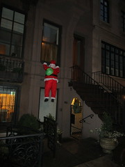 Another Damn Santa Breaking and Entering 5418 (Brechtbug) Tags: tis season for breaking entering santa claus trapped dangling from second floor brownstone buildings window display holiday statue mannequin christmas decor decoration chris kringle saint nicholas beard jolly holidays xmas red suit upper east side 63rd street uptown manhattan december 12232017 nyc 2017 new york city