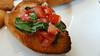 Bruschetta with an edge (Roving I) Tags: bruschetta italiancuisine toast tomatoes cafes gecko hue vietnam