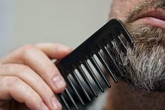 Santa getting ready (raisalachoque) Tags: face christmastime hair closeup hand comb beard 7dwf sundaylights christmasspirit cof012dmnq