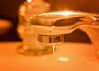 Candlelit bath. (Jenny Onsager) Tags: macromondays candlelit candlelight facet macro golden glow water faucet bath long exposure