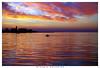 al centro del tramonto (Giorgio Serodine) Tags: trieste molo mare cielo tramonto orizzonte canon tele barca persona riflessi allaperto coloreforte citta edifici porto