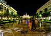 Night in Ho Chi Minh City, Vietnam (` Toshio ') Tags: toshio vietnam hochiminhcity saigon asia asian cityhall building night rain couple people hochiminhcitypeoplescommittee hôteldeville fujixe2 xe2 man woman rexhotel