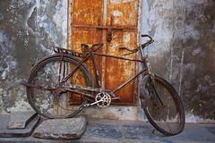 Broken Back Hero (Bradbury Lense) Tags: bicycle distress door hero india old rajasthan rust tires udaipur