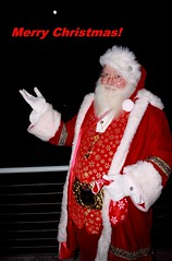 It's Almost Time! (PelicanPete) Tags: merrychristmas florida fortlauderdalebeach fortlauderdaleflorida unitedstates usa santaclaus moon kriskringle beard itsalmosttime 12217 portrait gloves pose expression grin red rail onthebeach fun flash nightshot belt key costume glasses harborbeachmarriott