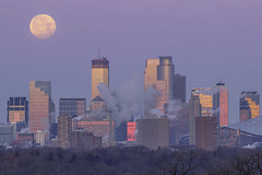 Moonset (Sam Wagner Photography) Tags: full super moon supermoon wolf january 2018 minneapolis minnesota blue twilight hour telephoto compression close up city cityscape skyline skyscrapers winter cold steam stack bare trees big far away pink hazy sky distortion