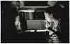 Consulting the Archive (Ivan Pistone) Tags: durst da900 canon ftb fd 50mm f14 114 ilford multigrade fiber paper print condenser delta 100 mirrored reflected riflesso specchio specchiato dark room carta baritata mirror miroir reflet papier baryté noiretblanc bw biancoenero film pellicola chambre noire camera oscura cigarette sigaretta