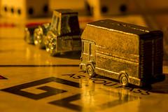"""GO"" Lit By Candlelight (Nicoli OZ Mathews) Tags: macro mondays macromondays litbycandlelight light candlelight night beautiful art bus monopoly boardgames toys"