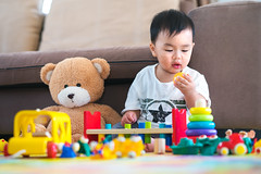 Asian boy play a toy with teddy bear in lieving room (I love landscape) Tags: baby toys toy child kid playing play childhood boy cute toddler little fun game beautiful color small portrait kids infant person happy background thai asian asia teddy bear leisure adorable innocence dough colorful young room education smiling floor ring object human analysis idea work sit lieving sofa chinese japanese korean