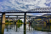 A collection of bridges (Marian Pollock) Tags: europe portugal porto bridges reflections clouds river douro mountain shoreline sunny weather person silhouette car cloudy brickwork arches shadows