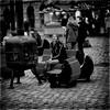 Winter Scene (Fouquier ॐ) Tags: girl bench fire monochrome cobblestones street people stove