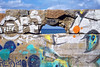 Room with a view. (Gudzwi) Tags: zimmermitaussicht roomwithview mauer wall stein stone stonewall steinmauer graffiti sprayer fenster window loch hole mauerloch mauerdurchblick wallview wallhole meer sea seaside ostsee balticsea rügen bunt colorful sky bluesky blauerhimmel himmel 7dwf wasser water 7dwfsaturdayslandscapes landscapes