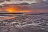 Sunrise over Hallig Oland (Markus Trienke) Tags: langenes schleswigholstein deutschland de sunrise hallig oland mud waddensea ocean sea water sunset sun clouds sky landscape seascape