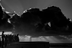 Watching the sunset (Ivona & Eli) Tags: clouds rays beams tlv israel bw