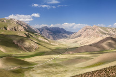 On the Road (Joost10000) Tags: sky grass mountains clouds mountain road landscape landschaft scenic beauty wild wilderness green outdoors canon canon5d eos view narynoblast asia centralasia kyrgyzstan explore travel