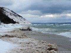 Frozen Empire (JamesEyeViewPhotography) Tags: lake michigan beach ice sand water waves sky clouds winter dunes trees northernmichigan landscape nature snow greatlakes jameseyeviewphotography