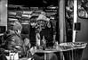 Bouquinistes frigorifiés! / Frozen booksellers! (vedebe) Tags: humain human people homme noiretblanc netb nb bw monochrome ville city rue street urbain urban livres bouquins portraits portrait travail