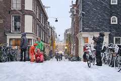 Kids sliding off the canal bridge in the snow blizzard (B℮n) Tags: amsterdam snow covered bikes bycicles holland netherlands canals winter cold wester church jordaan street anne frank house dutch people scooter gezellig cafés snowy snowfall atmosphere colorful windows walk walking bike cozy light rembrandt corner water canal weather cool sunset celcius mokum pakhuis grachtengordel unesco world heritage sled sleding slee nowandthen seagulls meeuwen bycicle 1°c sun shadows sneeuw brug slippery glad flakes handheld wind café anton pieck derdeegelantiersdwarsstraat slide sleigh sledge 50faves topf50 100faves topf100