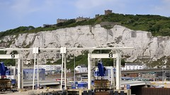 Leaving port for France - Dover, Kent, England. (edk7) Tags: nikond300 edk7 2011 uk england kent dover dovercalaisferry port castle whitecliffs cliff chalk machinery wharf jetty architecture building structure town city cityscape urban industrial mechanical landscape geology tree road bridge sign signage