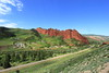 Let's Red Rock and Roll (Eye of Brice Retailleau) Tags: angle beauty composition landscape nature outdoor panorama paysage perspective scenery scenic view extérieur vanishing point ciel blue sky sunny backpacking earth mountain mountains road route travel wide central asia jetioguz kyrgyzstan village countryside