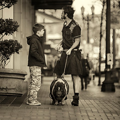 Pig In The City (Ian Sane) Tags: ian sane images piginthecity man boy pig kilt downtown portland oregon pioneer place sepia candid street photography canon eos 5ds r camera ef70200m f208l is usm lens