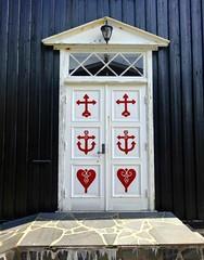 The door (Jaedde & Sis) Tags: føroyar hov suðuroy kirkja church door red symbols challengeyouwinner 15challengeswinner