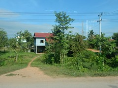On the Way Back to Phnom Penh (mikecogh) Tags: road house wires path telegraphpole cambodia