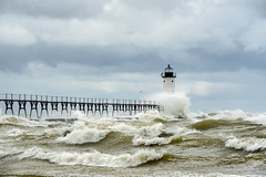 Headwind (Aaron Springer) Tags: michigan northernmichigan lakemichigan thegreatlakes manisteenorthpierheadlight lighthouse waves water clouds weather storm gale outdoor nature landscape