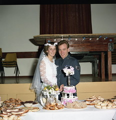 Cutting the wedding cake (vintage ladies) Tags: wedding 80s 80swedding 9111985 1985 miltonmalsor unknownpeople bride weddingdress woman lady 80slady 80swoman groom brideandgroom uniform male portrait people photograph smile smiling