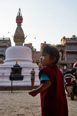 Nepali baby in front of a stupa, Kathmandu, Nepal (Alex_Saurel) Tags: statue portrait mère salwarkameez portraiture posing portray halfbody asie queuedecheval culture sunset 35mmprint pavés scans pose evening child asian pattern motif stupa group people cheveuxnoirs asia streetscene cobblestones architecture travel hands lifescene imagetype bouche photospecs photoreport woolcoat yeux baby redcoat photoreportage enfantnépalais littlechild goldenlight arms mother goldenstupa reportage stupatower eyes nepalichild photojournalism stockcategories ponytail mouth day plantaille blackhairs traditional time goldenhour tradition shorten nepal woman scènedevie lifestyles sony50mmf14sal50f14