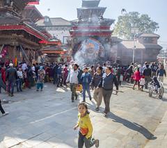 In Durbar Square, Kathmandu (Tim Brown's Pictures) Tags: nepal kathmandu durbarsquare people temple squareformat color girl child running statueofkalbhairava hindugod shiva
