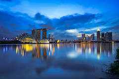 Singapore city skyline at dusk (Patrick Foto ;)) Tags: architecture asian background bay blue building business center central city cityscape commercial copyspace district downtown dusk evening exterior famous finance financial illuminated landmark landscape light marina metropolis modern night office outdoors reflection river riverside sea singapore sky skyline skyscraper southeast structure tourism tower town travel twilight urban water waterfront wheel sg